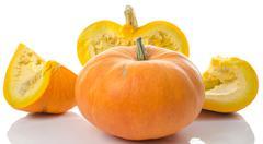 Nice big pumpkins cut into quarters - stock photo