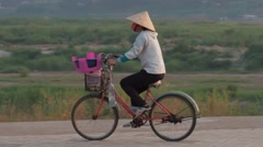 Manicuurster looking for customers at the Mekong river,Vientiane,Laos Stock Footage
