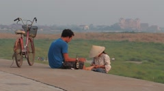 A man and  manicuurster at Mekong shore,Vientiane,Laos Stock Footage