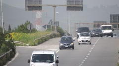 Motorway in Soutern Europe, cars, trucks at day, long zoom. Stock Footage