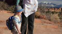 Little boy and mother in arches national park Stock Footage