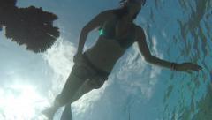 UNDERWATER: Female snorkeling above the coral reef in Indian Ocean Stock Footage