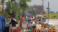 Cooking on the street restaurant at the Mekong,Vientiane,Laos Stock Footage
