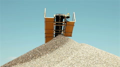 Sand falling from conveyor belt and forming pile. Separating of sand, open pit. Stock Footage