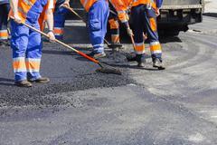 Asphalting and Repair of roads Stock Photos