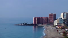 Beach hotel deep blue sky sand waves Stock Footage