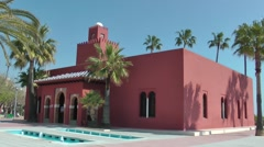Bil Bil castle Andalucia red building deep blue sky palm trees Stock Footage