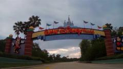 Passing under Disney World sign in Orlando Florida Stock Footage