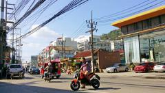PATONG, PHUKET, THAILAND - CIRCA JAN 2015: Light traffic on a bright sunny da Stock Footage