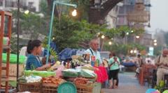 Girl makes papaya salad at the Mekong,Vientiane,Laos Stock Footage