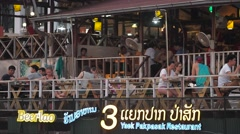Tourists at a bar at the Mekong shore,Vientiane,Laos Stock Footage