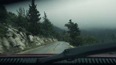 Pov driving mountain road at winter rain fog mist Stock Footage