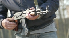 Man firing an assault rifle AK-47, slow motion. Stock Footage