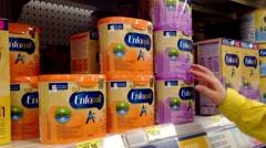 Woman choosing milk powder inside Walmart store. Stock Footage