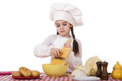 Beautiful little chief cooker on the desk with vegetables Stock Photos