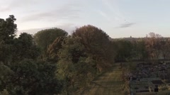 Aerial shot in Inverleith park, Edinburgh during sunrise - stock footage