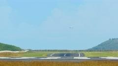 Jet airliner descending to landing - stock footage