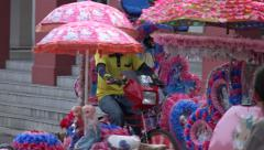 Bicycle trishaw taxi rides past tourists, Melaka, Malacca, Malaysia Stock Footage
