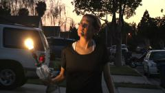 Climate change female walking lamp energy golbal warming outdoors clean power Stock Footage