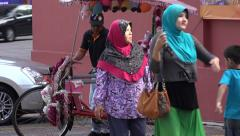 Muslim family takes bicycle trishaw taxi, Melaka, Malacca, Malaysia Stock Footage