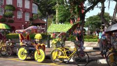 Row of bicycle trishaw taxis, Melaka, Malacca, Malaysia Stock Footage
