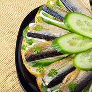 Sandwich with sprats and green cucumber Stock Photos
