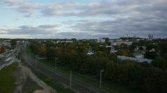 Empty railway city skyline trees aerial panoramic clouds Stock Footage