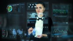 Girl at hologram board screens making business futuristic nano technologies Stock Footage