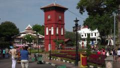 Tourists visit Clocktower, Melaka, Malacca, Malaysia Stock Footage