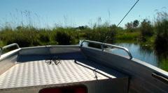 Boat trip canal okavango delta Botswana Africa Stock Footage