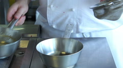 Chef cooking and preparing food in restaurant kitchen. Stock Footage