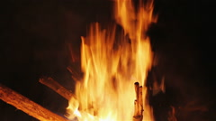 Stock Video Footage of Charming bonfire flame blazing in the night, vertical panning camera motion