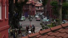 Zoom out from traffic to Clocktower, Melaka, Malacca, Malaysia Stock Footage