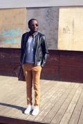 Outdoor fashion portrait of stylish young african man standing in the city - stock photo