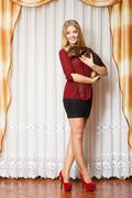 Elegant woman with her mixed dog Stock Photos