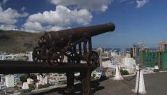 Old cannon with the Port Louis city at the background, Port Louis, Mauritius. Stock Footage