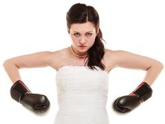 Wedding. Bride in boxing gloves. Emancipation. - stock photo