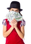 Dreaming girl with money in hands Stock Photos