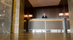 Hotel manager receiving guests - stock footage