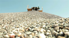 Sand and stones falling down from conveyor belt and forming a pile, low angle. Stock Footage