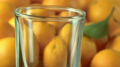 Orange juice being poured into glass Stock Footage