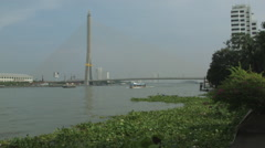 Rama VIII Bridge as seen from the Chao Phraya River in Bangkok, Thailand Stock Footage