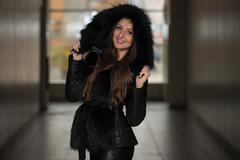 Fashion Girl Wearing Snow Jacket In Shopping Mall - stock photo