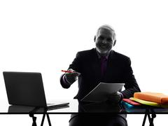 Senior business man contract signing proposal silhouette Stock Photos