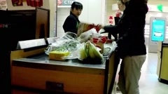 One side of check out counter inside T&T supermarket Stock Footage
