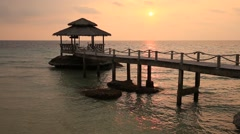 Tropical sunset on the sea. Wooden pier in Island Koh Kood, Thailand Stock Footage