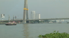 Rama VIII Bridge as seen from the Chao Phraya River in Bangkok, Thailand Stock Footage