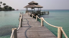 Wooden pier and beautiful sea water. Beach in island Koh Kood, Thailand Stock Footage