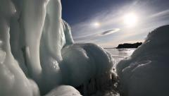 Big icicles on the rock against sunny sky Stock Footage