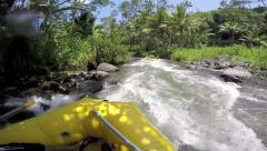 Whitewater rafting down river rapids Stock Footage